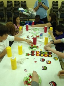 KWAM Kids making crafts for nursing home residents.